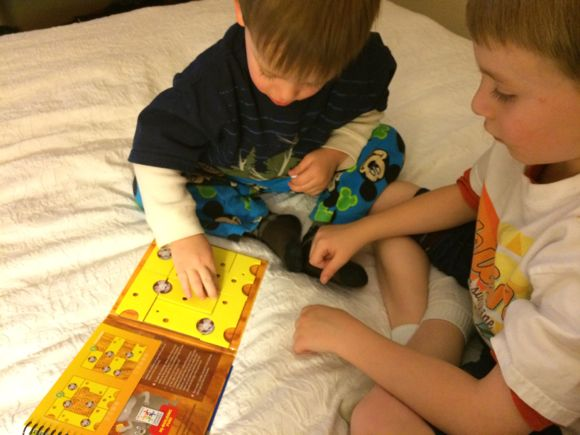 After a day full of exploring a new city, he boys had so much fun solving each challenge while realizing in our hotel room.