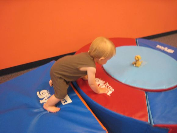 Mommy and Me Classes help kids increase their mobility by teaching them to climb up and over large mats and through tunnels!