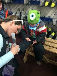 Trevor's foot was measured before getting his first ski boots!