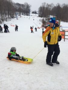 Trevor sat in the sled without any resistance thanks to the welcoming personality of his instructor!