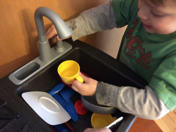Trevor had so much fun filling the cups up with water!