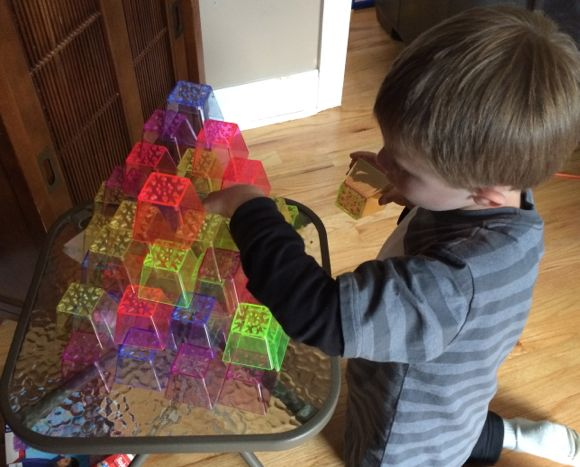 By carefully stacking each cup, kids build valuable fine motor and visual skills!