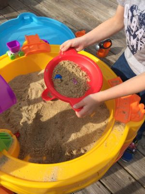 There are so many opportunities for kids to learn cause and effect with the Little Tikes Treasure Hunt Sand and Water Table!