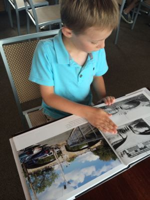 Tyler loved looking through the Then and Now Book and referring to it throughout the cruise!