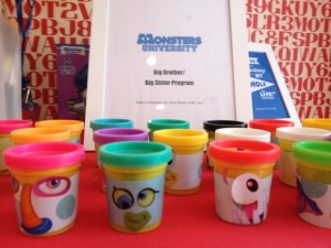 For my kids' Monsters Inc. themed party, I turned Play Doh cans into monsters!