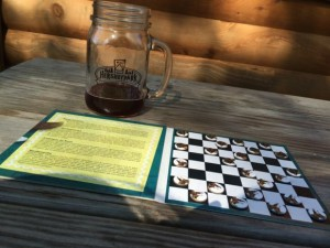 Playing Checkers is fun way to pass the time while camping!