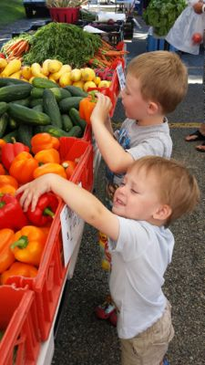 Boys at Farmers Market with Peppers