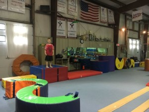 Gymnastics is great sport to let kids try this summer!