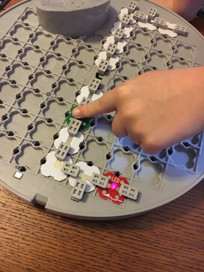Certain experiments teach kids what happens if they press a button once the design is created.