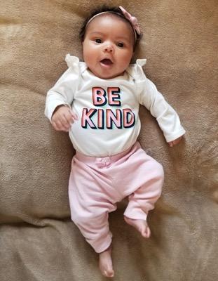 Baby in Be Kind Onesie